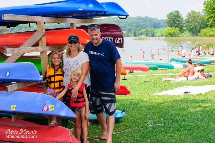 Heunis family at Marsh Creek with colorful canoes.